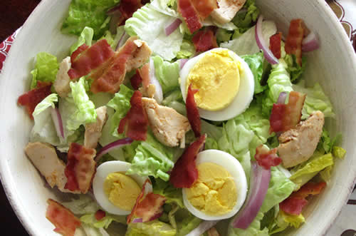 Chicken club salad, with bacon and hard-boiled eggs