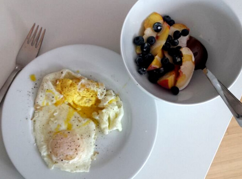 breakfast on vacation; eggs + fruit
